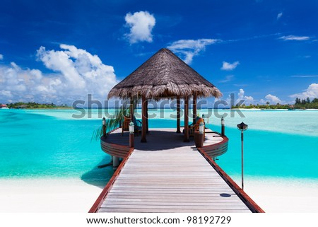 Jetty with amazing ocean view on tropical island - stock photo