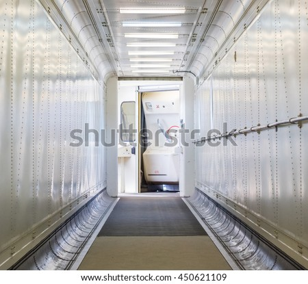 Jetway, walking towards the plane, seeing the door of the plane, selective focus - stock photo