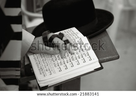 Jew praying at the Western Wall in Jerusalem. - stock photo