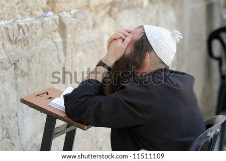 Jew prays in the wailing wall in Jerusalem - stock photo