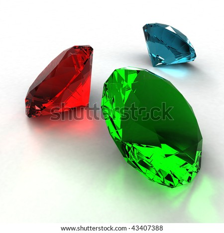 Jewel diamond of green, blue and red color on a white background - stock photo