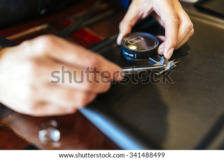Jeweler checking diameter of diamond