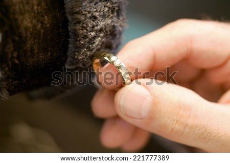 Jeweler polishing a ring