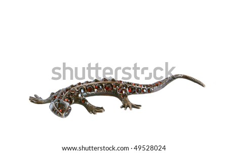 Jewelery - lizard figurine made of metal with natural grenades, isolation