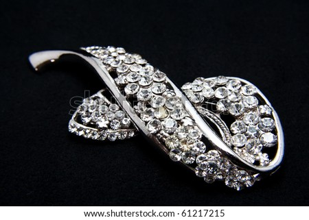 jewellery brooch isolated on black background - stock photo