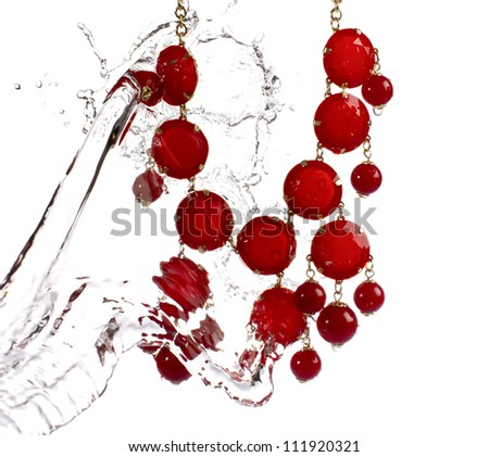 Jewellery Jewelry water splash necklace, high speed water splash - stock photo