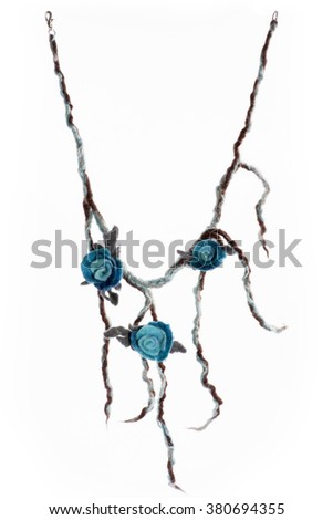 Jewellery made from felted wool on a white background