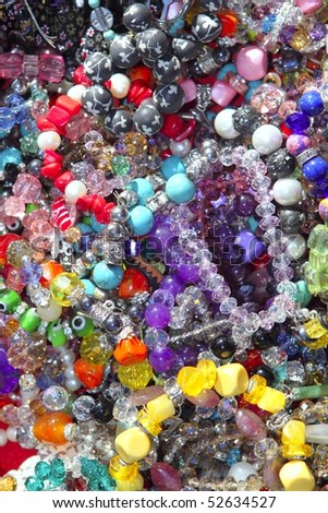 jewellery mixed colorful many jewels plastic jewelry background - stock photo