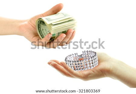 Jewelry and money on hands- pawnshop concept - stock photo