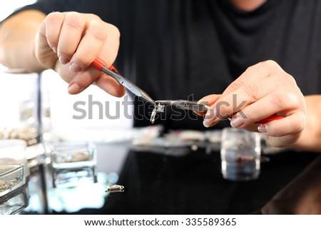 Jewelry, atelier jewelery.  Jeweler, goldsmith while working on silver jewelry  - stock photo