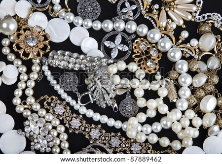 Jewelry background. Many beautiful jewelery - stock photo