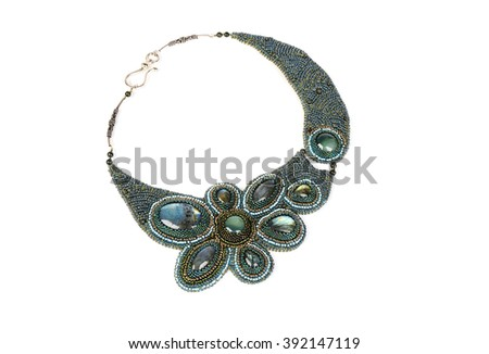 Jewelry. Beaded necklace with green stones isolated on white background - stock photo