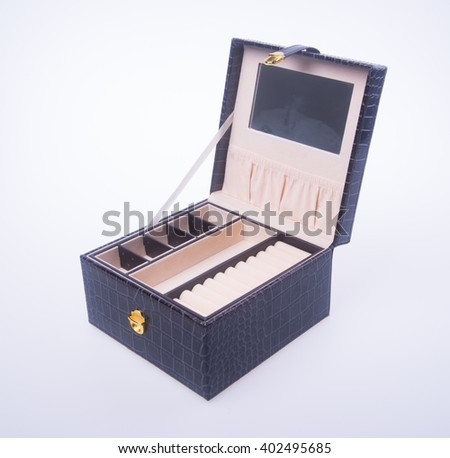 jewelry box or black leather jewelery box on background - stock photo