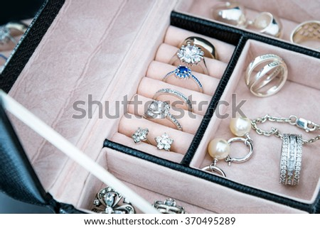 Jewelry box with white gold and silver rings, earrings and pendants with pearls. Collection of luxury jewelry - stock photo
