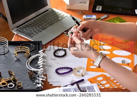 Jewelry designer - stock photo