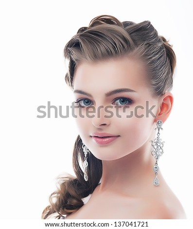 Jewelry. Glamorous Smiling Brunette with Brilliant Earrings. Sophistication - stock photo