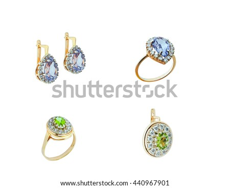 Jewelry set earrings and rings with gemstones isolated on the white background