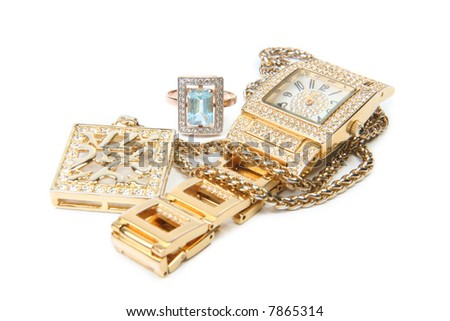 Jewelry set. Gold watch, necklace and ring. - stock photo
