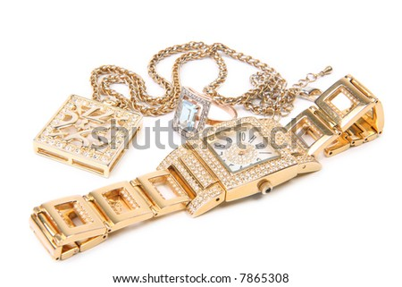 Jewelry set. Golden watch, ring and necklace.