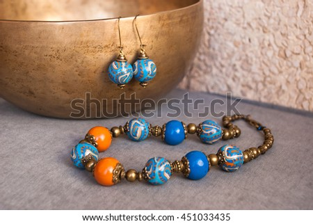 Jewelry set in oriental style. Bohemian necklace beads and earrings. Handmade jewellery of polymer clay. - stock photo