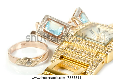 Jewelry set, ring, watch, earrings. Isolate on white. - stock photo