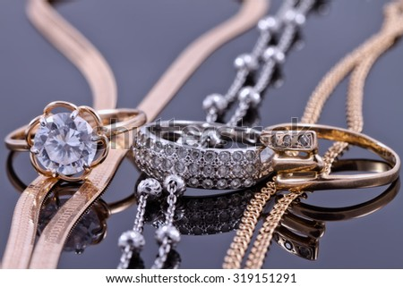 Jewelry sets of gold and silver: chain and ring - stock photo