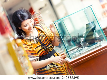 Jewelry shopping Asian woman at jewelry shop - stock photo