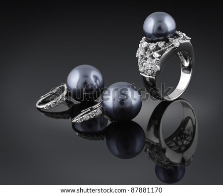 jewelry with black pearl and diamond - stock photo
