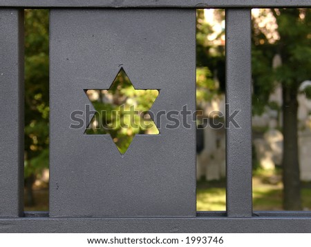 Jewish cemetery (2) through the paling, Prague, Zizkov, Czech republic - stock photo
