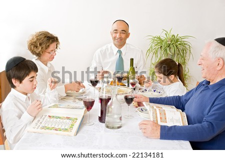 jewish family in seder celebrating passover - stock photo