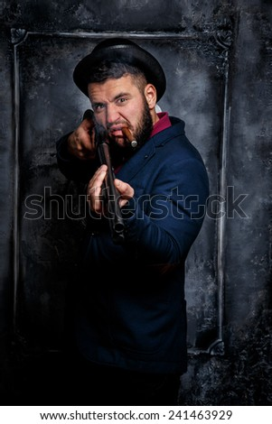 Jewish gansgter smoking a cig.Against art-wall on the background