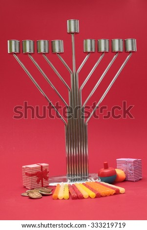 jewish holiday Hanukkah background with menorah candles, isolated on red background. - stock photo