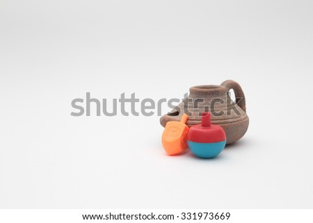 Jewish holiday hanukkah celebration  - Chanukah lamp, coins, candles, dreidels, oil jug, symbol of the holiday, isolated on a white background. - stock photo
