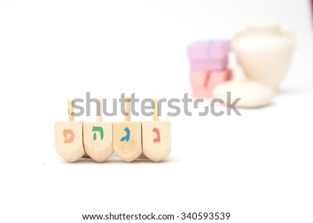 Jewish holiday hanukkah celebration - Dreidels on a white background isolated - stock photo