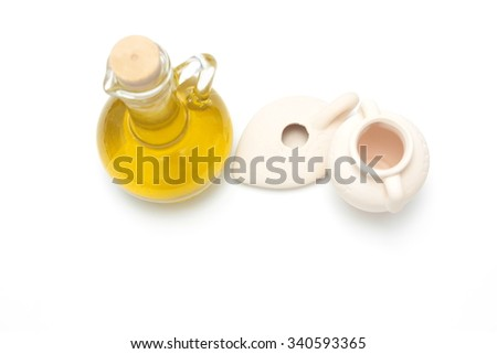 Jewish holiday hanukkah celebration -  jug, oil, currencies, on white background isolated - stock photo