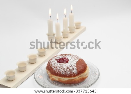 Jewish holiday hanukkah celebration with vintage menorah, donuts, dreidels, jug, on a white background - stock photo