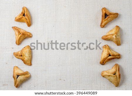 Jewish holiday of Purim. Hamantaschen cookies on canvas background with free space for text - stock photo