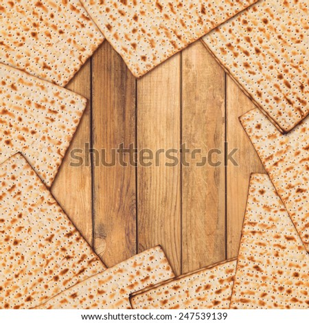 Jewish holiday Passover background. Matzo on wooden table with copy space - stock photo