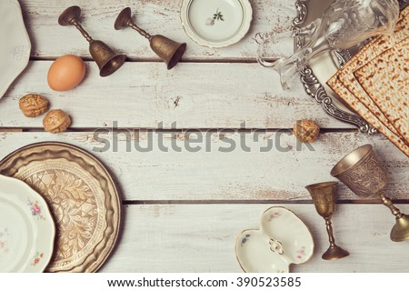 Jewish holiday Passover background with plates. View from above. Flat lay