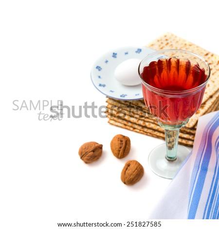 Jewish holiday Passover celebration with matzo and wine on white background - stock photo