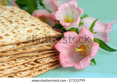 jewish matzo bread on a table with flowers - stock photo