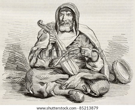 Jewish musician in Mogador, Morocco, old illustration. Created by Delacroix, published on Magasin Pittoresque, Paris, 1842 - stock photo