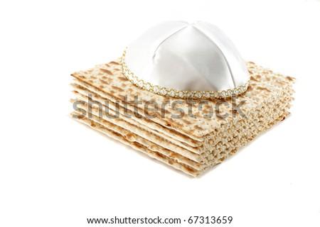 Jewish Passover holiday still life with matzoh and kippah on white background - stock photo