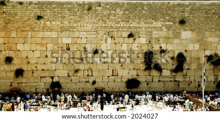 Jewish people praying at the most holy place for Jews - stock photo