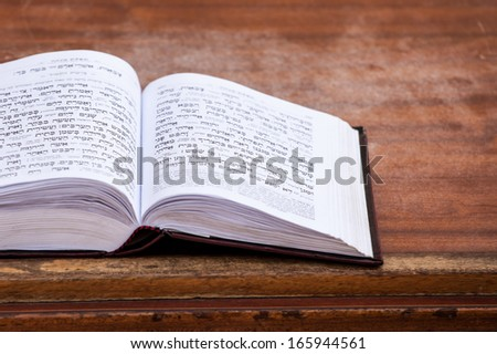 Jewish praying book on table. - stock photo