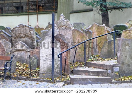Jewish Quarter (Josefov) cemetery with stack of old tomb stones, Prague , Czech Republic - stock photo