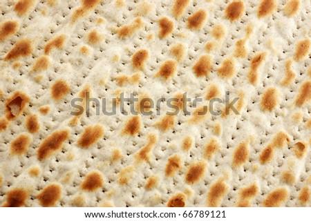 Jewish ritual holiday food unleavened bread  -matzoh (background) - stock photo