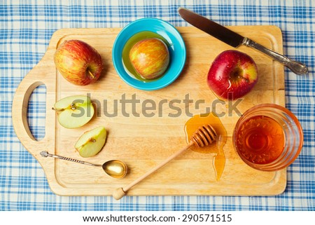 Jewish Rosh hashana (new year) background with apples and honey. View from above - stock photo