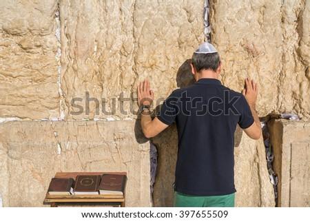Jewish tourist prays in the wailing wall of Jerusalem, Israel - stock photo
