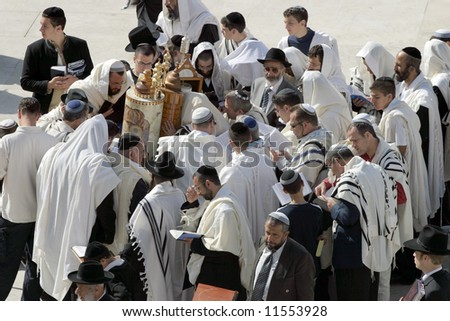 Jews pray in the western wall in Jerusalem. - stock photo